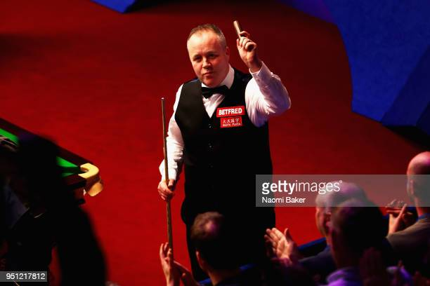John Higgins of Scotland celebrates after winning his first round match against Thepchaiya UnNooh of Thailand during day five of the World Snooker...