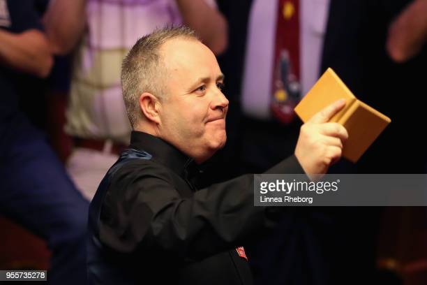 John Higgins of Scotland celebrates with his silver medal after losing the final to Mark Williams of Wales during day seventeen of World Snooker...