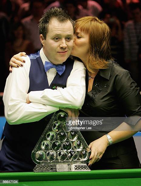 John Higgins of Scotland gets a kiss from his wife Denise after beating Ronnie O'Sullivan of England during The Masters 2006 Final at Wembley...