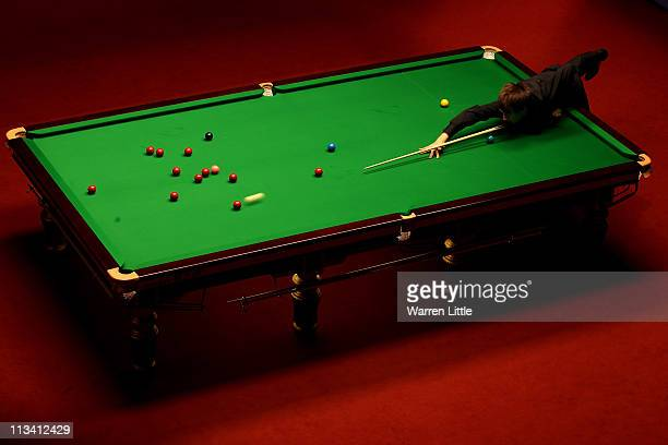 John Higgins of Scotland in action against Judd Trump of England during the final of the Betfredcom World Snooker Championship at the Crucible...