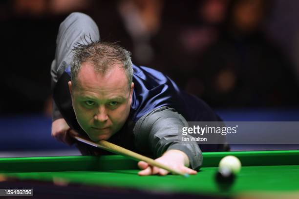 John Higgins of Scotland in action during his first round match against Ali Carter of England at Alexandra Palace on January 14 2013 in London England