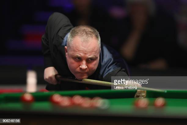John Higgins of Scotland in action during his first round match against Anthony McGill of Scotland on day four of The Dafabet Masters at Alexandra...