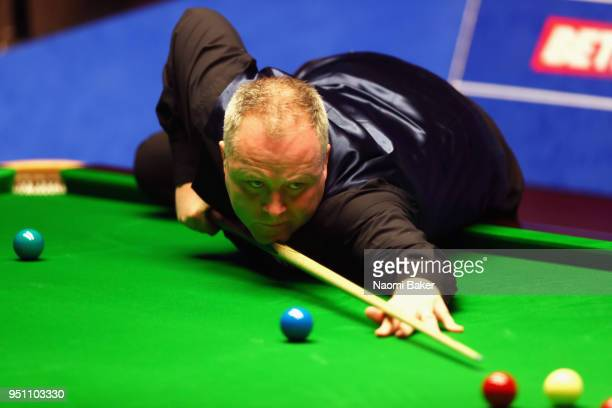 John Higgins of Scotland in action during his first round match against Thepchaiya UnNooh of Thailand during day five of the World Snooker...