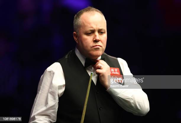John Higgins of Scotland in action during his first round match against Ryan Day of Wales during day one of The Dafabet Masters at Alexandra Palace...