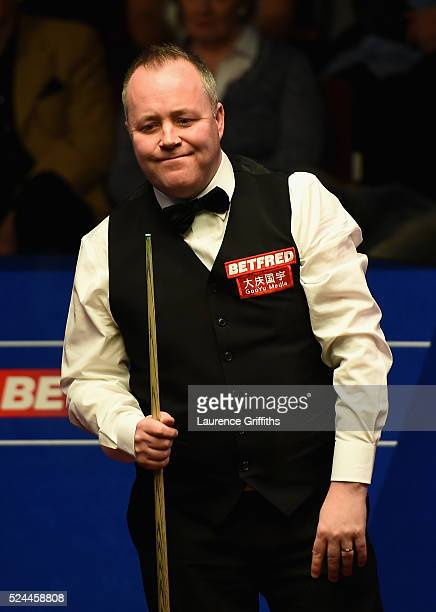 John Higgins of Scotland in action during his quarter final match against Alan McManus of Scotland on day eleven of the World Championship Snooker at...