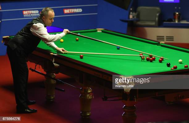 John Higgins of Scotland in action during the final against Mark Selby of England on day seventeen of the World Snooker Championship on day seventeen...
