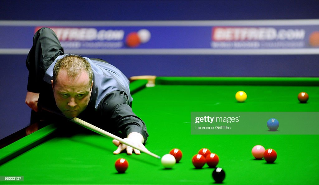 John Higgins of Scotland in action in his match against Steve Davis of England during the Betfred.com World Snooker Championships match at The Crucible Theatre on April 23, 2010 in Sheffield, England.