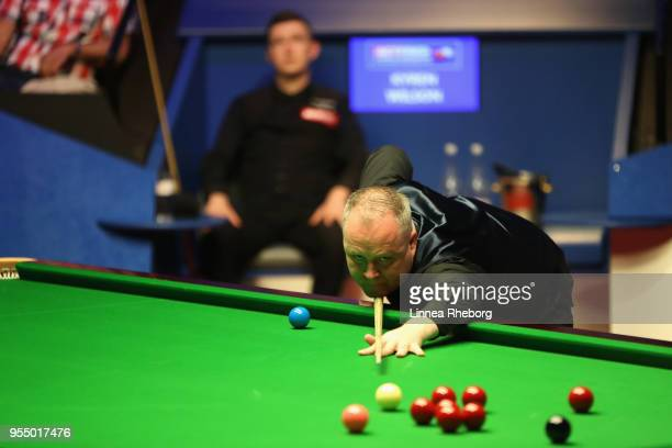 John Higgins of Scotland in action in his semifinals match against Kyren Wilson of England during day fifteen of World Snooker Championship at...