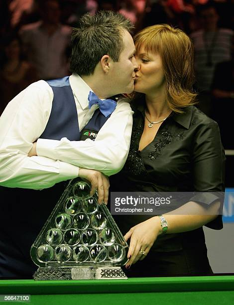 John Higgins of Scotland kisses his wife Denise after beating Ronnie O'Sullivan of England during The Masters 2006 Final at Wembley Conference Centre...