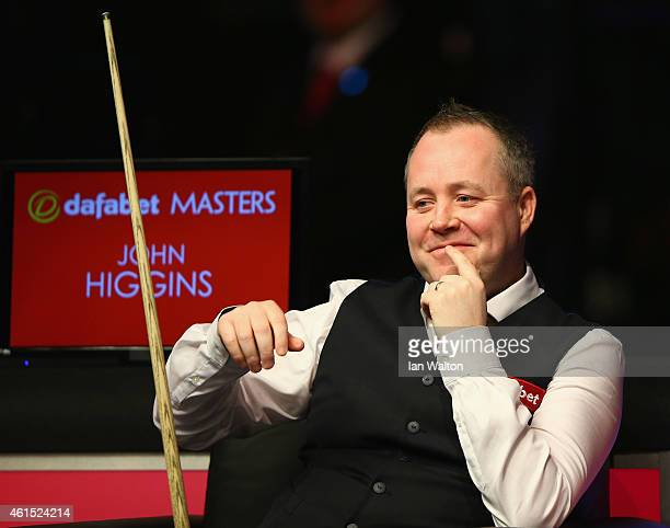 John Higgins of Scotland looks on during his first round match against Mark Allen of Northern Ireland on Day Four of the 2015 Dafabet Masters at...