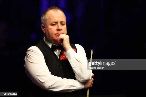 John Higgins of Scotland looks on during his first round match against Ryan Day of Wales during day one of The Dafabet Masters at Alexandra Palace on...