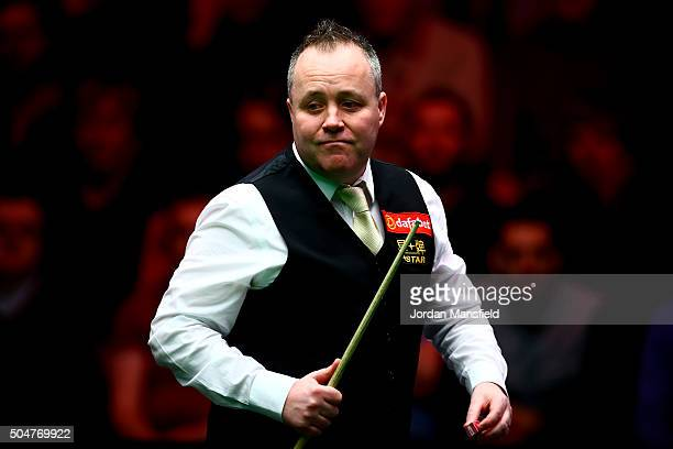 John Higgins of Scotland looks on in his first round match against Liang Wenbo of China during Day Four of the Dafabet Masters at Alexandra Palace on...