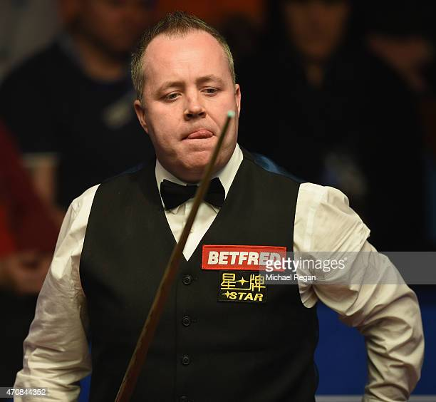 John Higgins of Scotland looks on in his match against Ding Junhui of China during day six of the 2015 Betfred World Snooker Championship at Crucible...