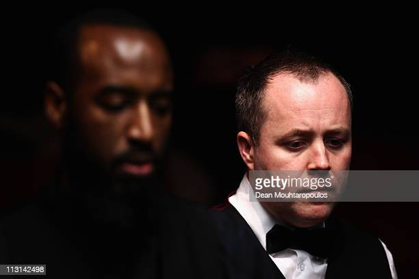 John Higgins of Scotland looks to play a shot in the round two game against Rory McLeod of Engalnd on day nine of the Betfredcom World Snooker...