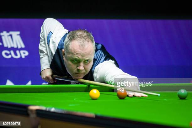 John Higgins of Scotland plays a shot against Thepchaiya UnNooh of Thailand and Noppon Saengkham of Thailand on day one of 2017 Snooker World Cup at...