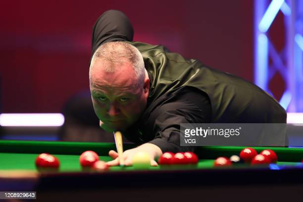 John Higgins of Scotland plays a shot during a quarter-final match against Judd Trump of England on day three of 2020 Coral Players Championship at...
