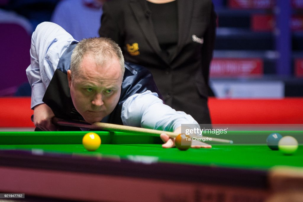 John Higgins of Scotland plays a shot during his first round match against Ali Carter of England on day two of 2018 Ladbrokes World Grand Prix at Guild Hall on February 20, 2018 in Preston, England.