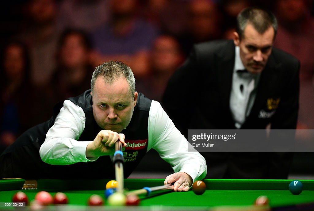 John Higgins of Scotland plays a shot during his quarter final match against Stuart Bingham of England during Day Six of The Dafabet Masters at Alexandra Palace on January 15, 2016 in London, England.