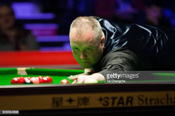 John Higgins of Scotland plays a shot during his quarterfinal match against Ronnie O'Sullivan of England on day five of 2018 ManBetX Welsh Open at...
