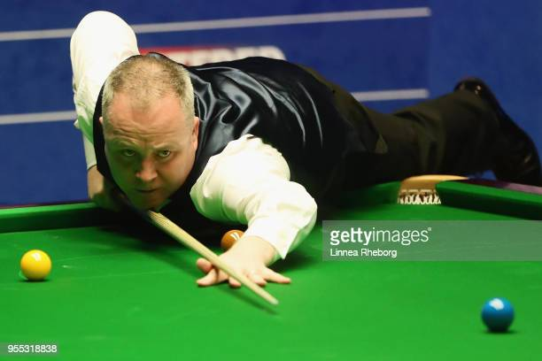 John Higgins of Scotland plays a shot during the first session of the final against Mark Williams of Wales during day sixteen of World Snooker...