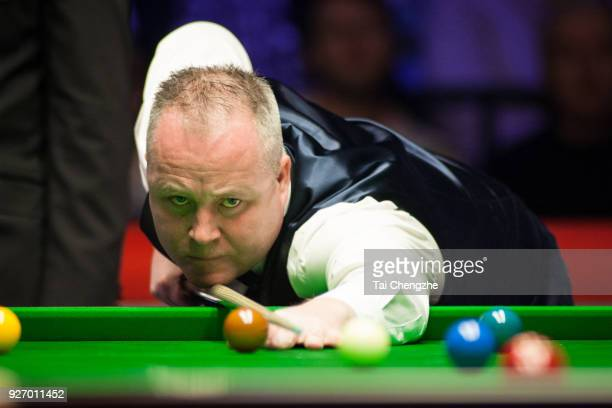 John Higgins of Scotland plays a shot during the semifinal match against Gary Wilson of England on day six of 2018 ManBetX Welsh Open at Motorpoint...