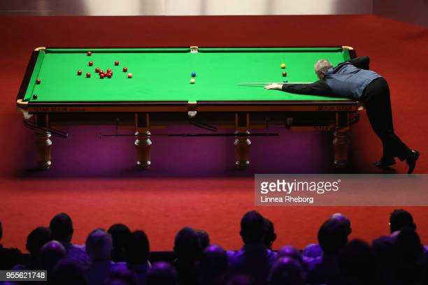 John Higgins of Scotland plays a shot during the third session of the final against Mark Williams of Wales during day seventeen of World Snooker...