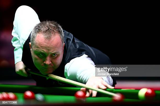 John Higgins of Scotland plays a shot in his first round match against Liang Wenbo of China during Day Four of the Dafabet Masters at Alexandra...