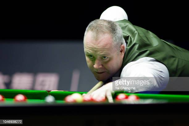 John Higgins of Scotland plays a shot in the final match against Mark Selby of England during day seven of the Evergrande 2018 World Snooker China...