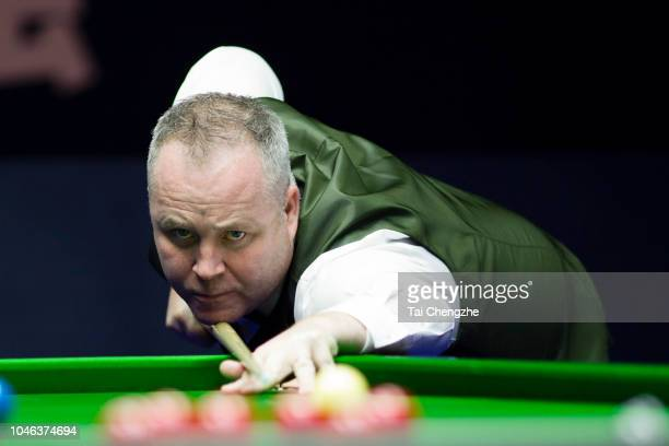 John Higgins of Scotland plays a shot in the semifinal match against Lyu Haotian of China during day six of the Evergrande 2018 World Snooker China...