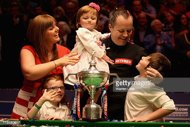 John Higgins of Scotland poses with his family after beating Judd Trump of England to win the Betfredcom World Snooker Championship at the Crucible...