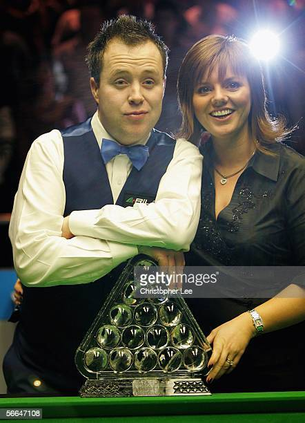 John Higgins of Scotland poses with his wife Denise after beating Ronnie O'Sullivan of England during The Masters 2006 Final at Wembley Conference...