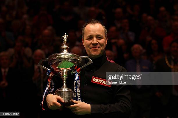 John Higgins of Scotland poses with the trophy after beating Judd Trump of England to win the Betfredcom World Snooker Championship at the Crucible...