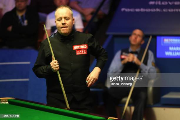 John Higgins of Scotland reacts after a shot during the fourth session of the final against Mark Williams of Wales during day sixteen of World...