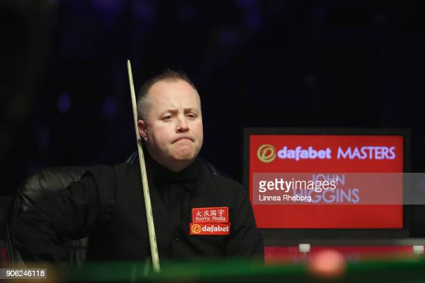 John Higgins of Scotland reacts during his first round match against Anthony McGill of Scotland on day four of The Dafabet Masters at Alexandra...