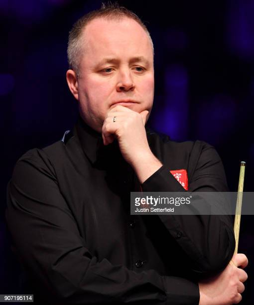 John Higgins of Scotland reacts during his match against Ryan Day of Wales during The Dafabet Masters on Day Six at Alexandra Palace on January 19...