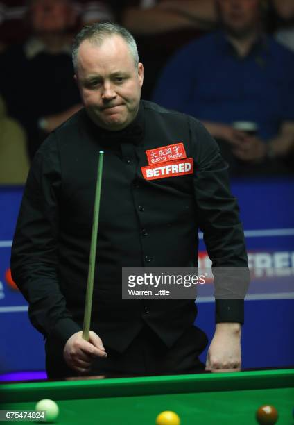 John Higgins of Scotland reacts during the final against Mark Selby of England on day seventeen of the World Snooker Championship on day seventeen at...