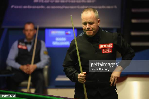 John Higgins of Scotland reacts during the fourth session of the final against Mark Williams of Wales during day sixteen of World Snooker...