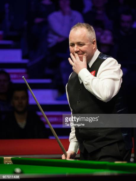 John Higgins of Scotland reacts during the semifinal match against Gary Wilson of England on day six of 2018 ManBetX Welsh Open at Motorpoint Arena...