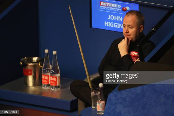 John Higgins of Scotland reacts during the third session of the final against Mark Williams of Wales during day seventeen of World Snooker...