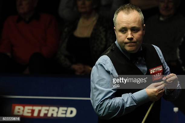 John Higgins of Scotland reacts in first round match against Ryan Day of Wales on day three of Betfred World Championship 2016 at Crucible Theatre on...
