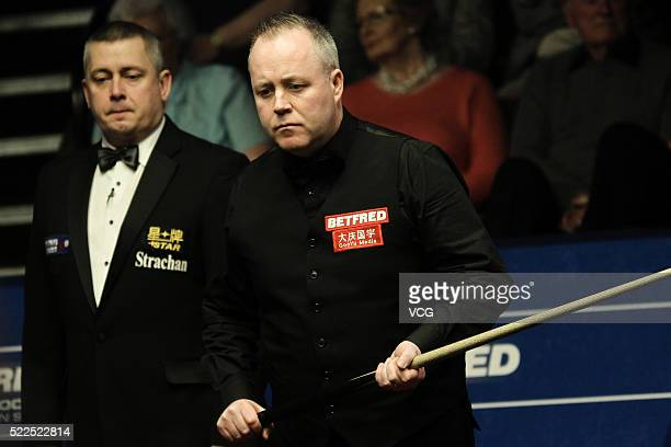 John Higgins of Scotland reacts in first round match against Ryan Day of Wales on day four of Betfred World Championship 2016 at Crucible Theatre on...