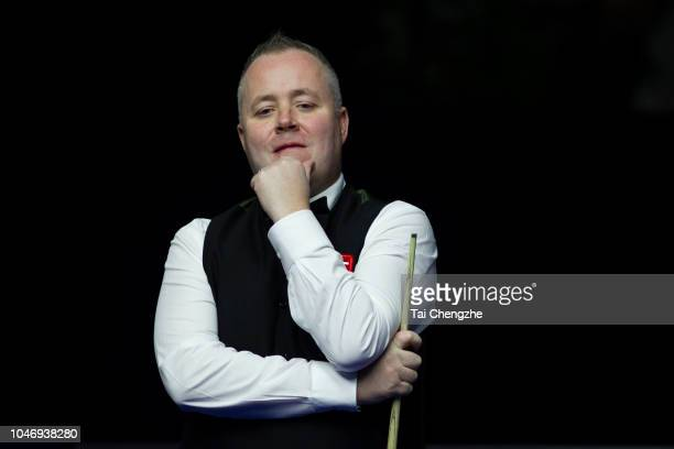 John Higgins of Scotland reacts in the final match against Mark Selby of England during day seven of the Evergrande 2018 World Snooker China...