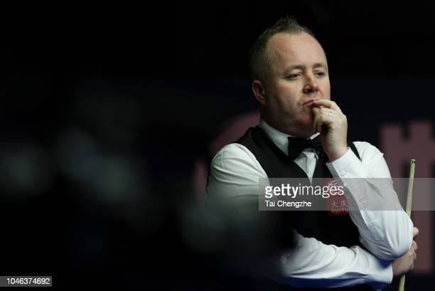 John Higgins of Scotland reacts in the semifinal match against Lyu Haotian of China during day six of the Evergrande 2018 World Snooker China...