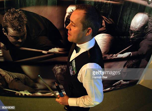 John Higgins of Scotland waits back stage ahead of his match against Ryan Day of Wales during day six of the 888com World Snooker Championships at...