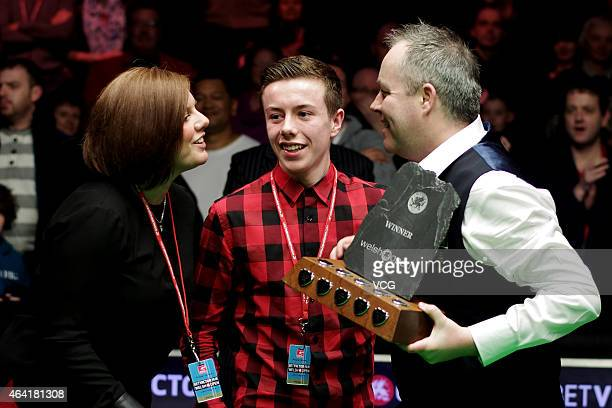 John Higgins of UK celebrates with his elder son Pierce Higgins and his wife Denise Higgins after winning the final match during day seven of 2015...