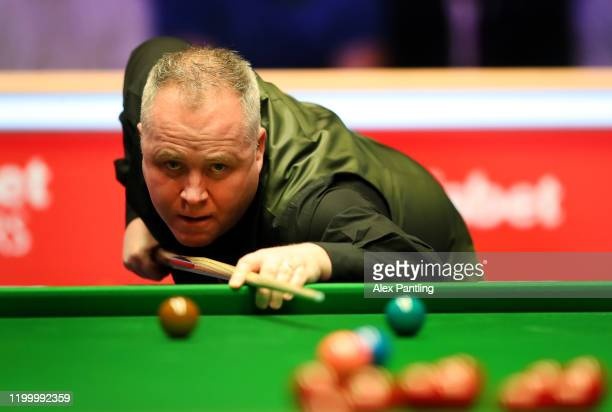 John Higgins plays a shot during the quarter-final match between Ali Carter of England and John Higgins of Scotland on day five of the 2020 Dafabet...