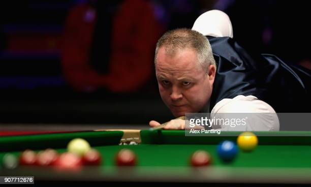 John Higgins plays a shot during the SemiFinal match between Mark Allen and John Higgins on Day Seven of The Dafabet Masters at Alexandra Palace on...