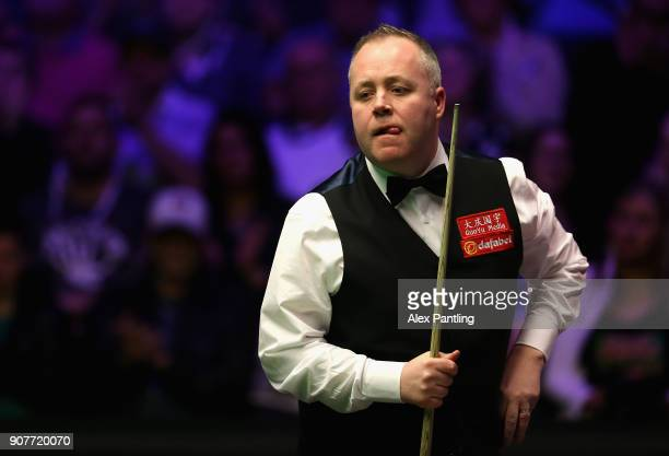 John Higgins reacts during the SemiFinal match between Mark Allen and John Higgins on Day Seven of The Dafabet Masters at Alexandra Palace on January...