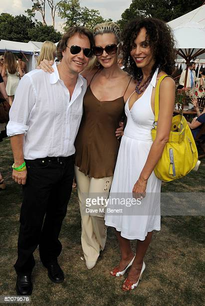 John Hitchcox Caprice and Jeanette Calliva attend the annual Cartier International Polo Day at the Cartier Marquee in Great Windsor Park on July 27...