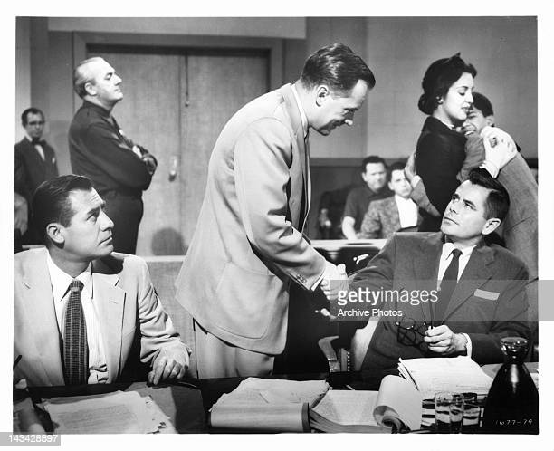 John Hodiak looks in amazement when Arthur Kennedy shakes the hand of Glenn Ford as Katy Jurado consoles Rafael Campos in the background in a scene...
